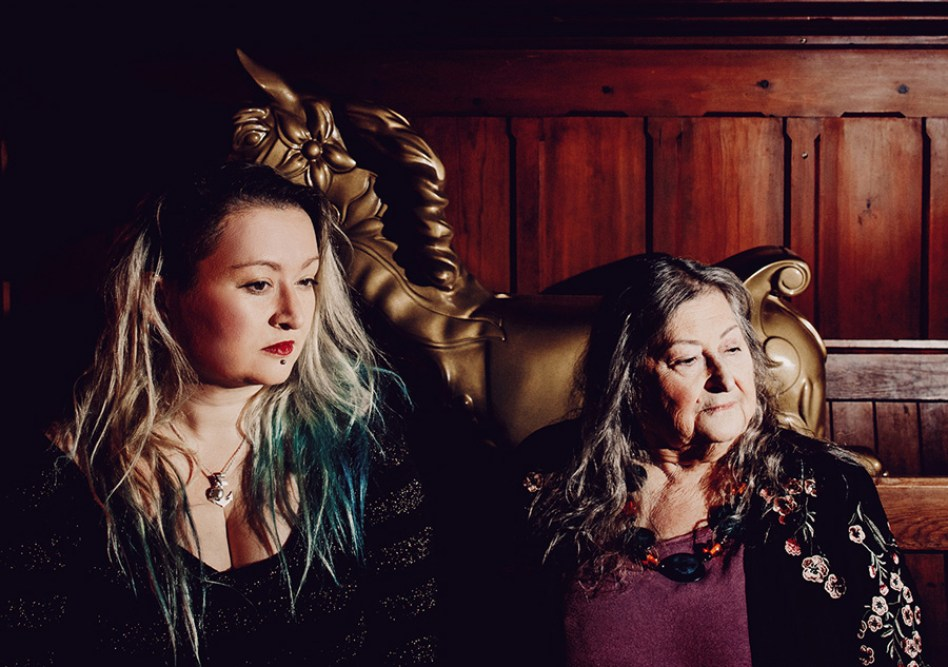 Eliza Carthy and Norma Waterson sit together for photographer, Elly Lucas